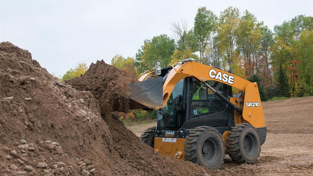 https://assets.cnhindustrial.com/casece/nafta/assets/Products/Skid-Steer-Loaders/SR210/CCE_SSL_photo_4-11-18_SR210_RJP1470.jpg