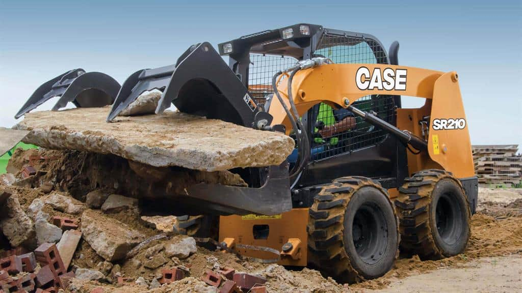 https://assets.cnhindustrial.com/casece/nafta/assets/Products/Skid-Steer-Loaders/SR210_Day03_ConstructionSite_0007r_effect.jpg