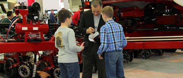 National Farm Machinery Show 2016 - Max Armstrong signed hats and talked to fans of all ages