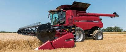 //assets.cnhindustrial.com/caseih/NAFTA/NAFTAASSETS/Products/Harvesting/Draper-Heads/General_Images/8240_Combine_1264_07-14.jpg?width=410&height=171