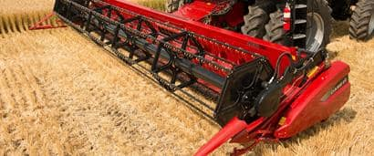//assets.cnhindustrial.com/caseih/NAFTA/NAFTAASSETS/Products/Harvesting/Grain-Head/2030-Grain-Head/6140_Combine_with_2030_Rigid_Draper_Header_1609_07-14_mr.jpg?width=410&height=171