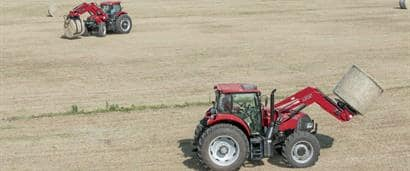 //assets.cnhindustrial.com/caseih/NAFTA/NAFTAASSETS/Products/Loaders-and-Attachments/L705-Series-Loaders/L775/Farmall_140A_and_Puma_185_tractors_1748_10-14.jpg?width=410&height=171