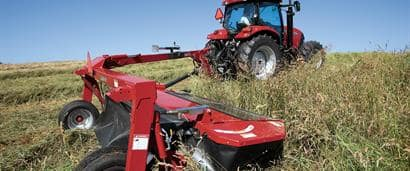 //assets.cnhindustrial.com/caseih/NAFTA/NAFTAASSETS/Products/Mowers-and-Conditioners/Pull-Type-Disc-Mowers/TD102/TD102_00307_03-09_mr.jpg?width=410&height=171