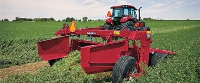 //assets.cnhindustrial.com/caseih/NAFTA/NAFTAASSETS/Products/Mowers-and-Conditioners/Rotary-Disc-Mower-Conditioners/DC103/Farmall%20140A%20and%20DC103_0533_08-18.jpeg?width=410&height=171