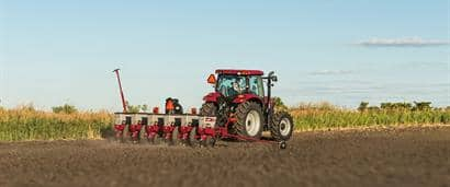 //assets.cnhindustrial.com/caseih/NAFTA/NAFTAASSETS/Products/Planting-and-Seeding/Early-Riser-Planter/1225-Rigid-Trailing/Maxxium_130_CVT_Tractor_Early_Riser_1225_Planter_0052_07-13_mr.jpg?width=410&height=171