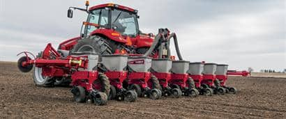 //assets.cnhindustrial.com/caseih/NAFTA/NAFTAASSETS/Products/Planting-and-Seeding/Early-Riser-Planter/1235-Mounted-Stacker/Magnum_240_CVT_Early_Riser_1235_Planter_AMSM_A-1093_05-01-13_mr.jpg?width=410&height=171