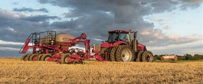 //assets.cnhindustrial.com/caseih/NAFTA/NAFTAASSETS/Products/Planting-and-Seeding/Early-Riser-Planter/1255-Front-Fold-Trailing/1255_Planter_with_Precision_Planting_0866_08-14_mr.jpg?width=410&height=171