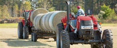 //assets.cnhindustrial.com/caseih/NAFTA/NAFTAASSETS/Products/Tractors/Farmall-100A-Series/General_Images/Farmall%20110A%20with%20Bale%20Wagon_8643_10-14.jpg?width=410&height=171