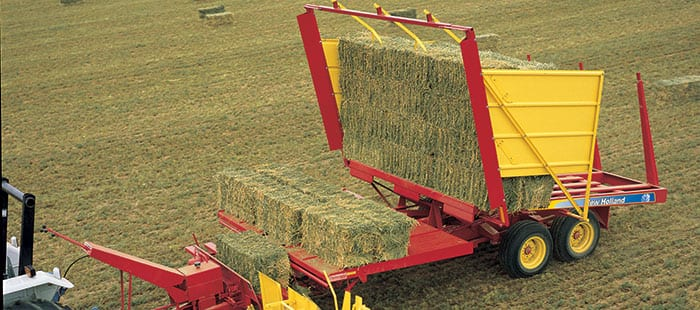 automatic-bale-wagons-clear-fields-of-bales-fast.jpg